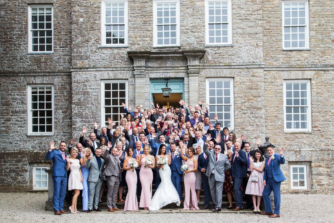 full wedding party posed on steps Kingston Estate