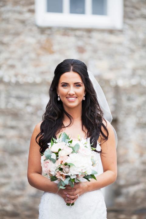 beautiful bride holding bouquet