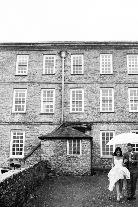 bride and groom under umbrella Kingston Estate
