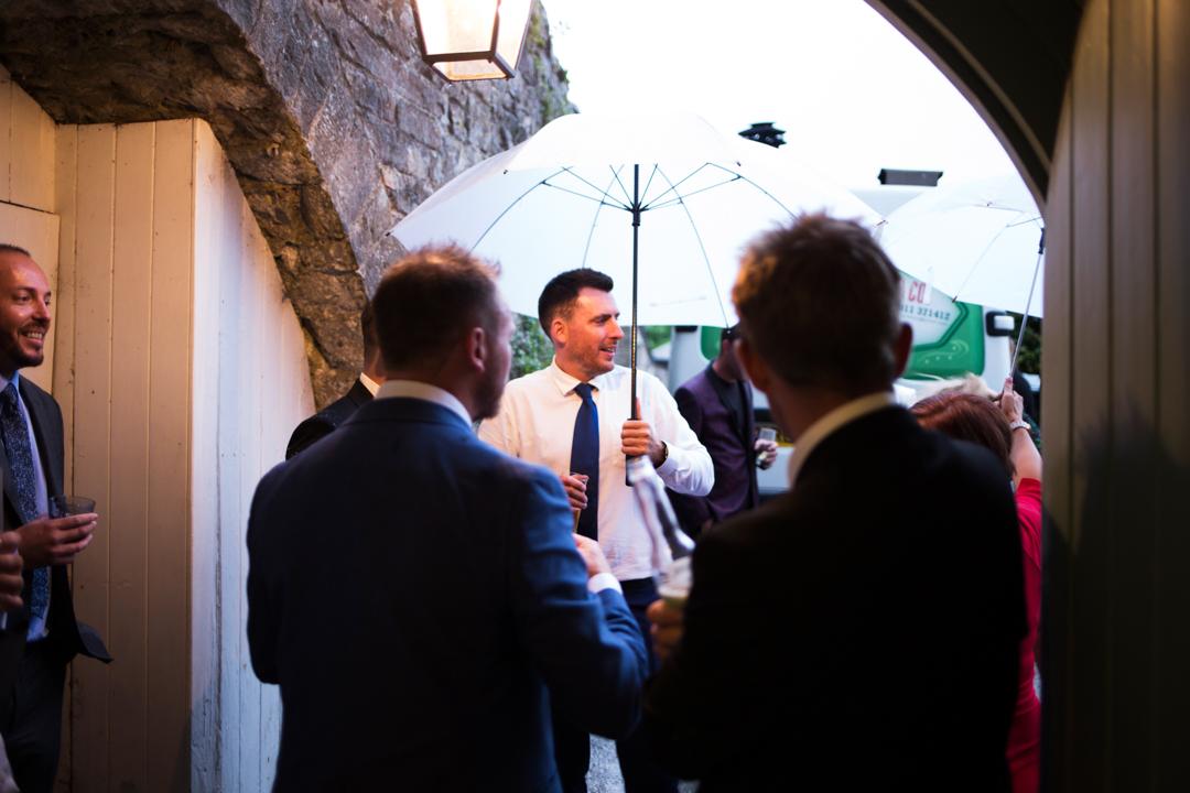 rain at a wedding can be fun