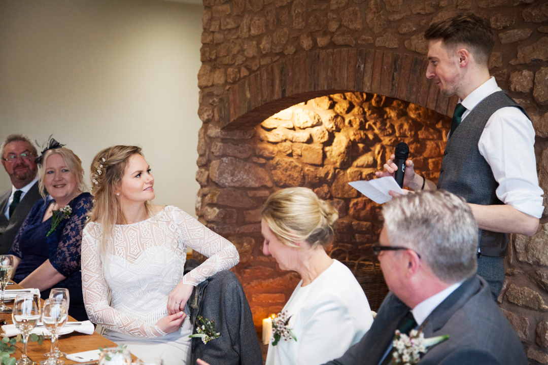 groom speaks to bride