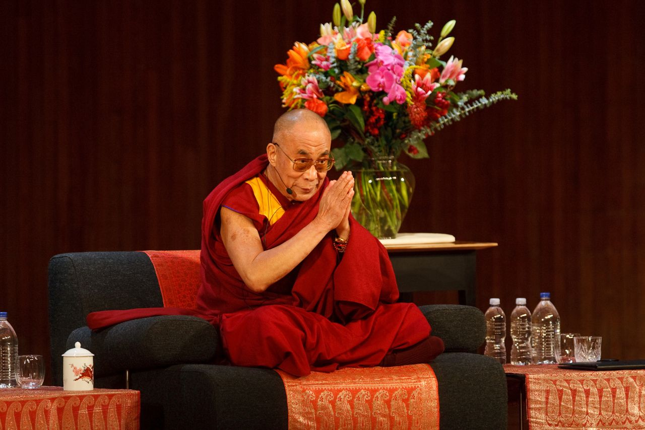 THE DALAI LAMA GIVING A TALK WITH OUR SHAKER NIGHTSTANDS BY HIS SIDE. BOSTON MA, 2008.
