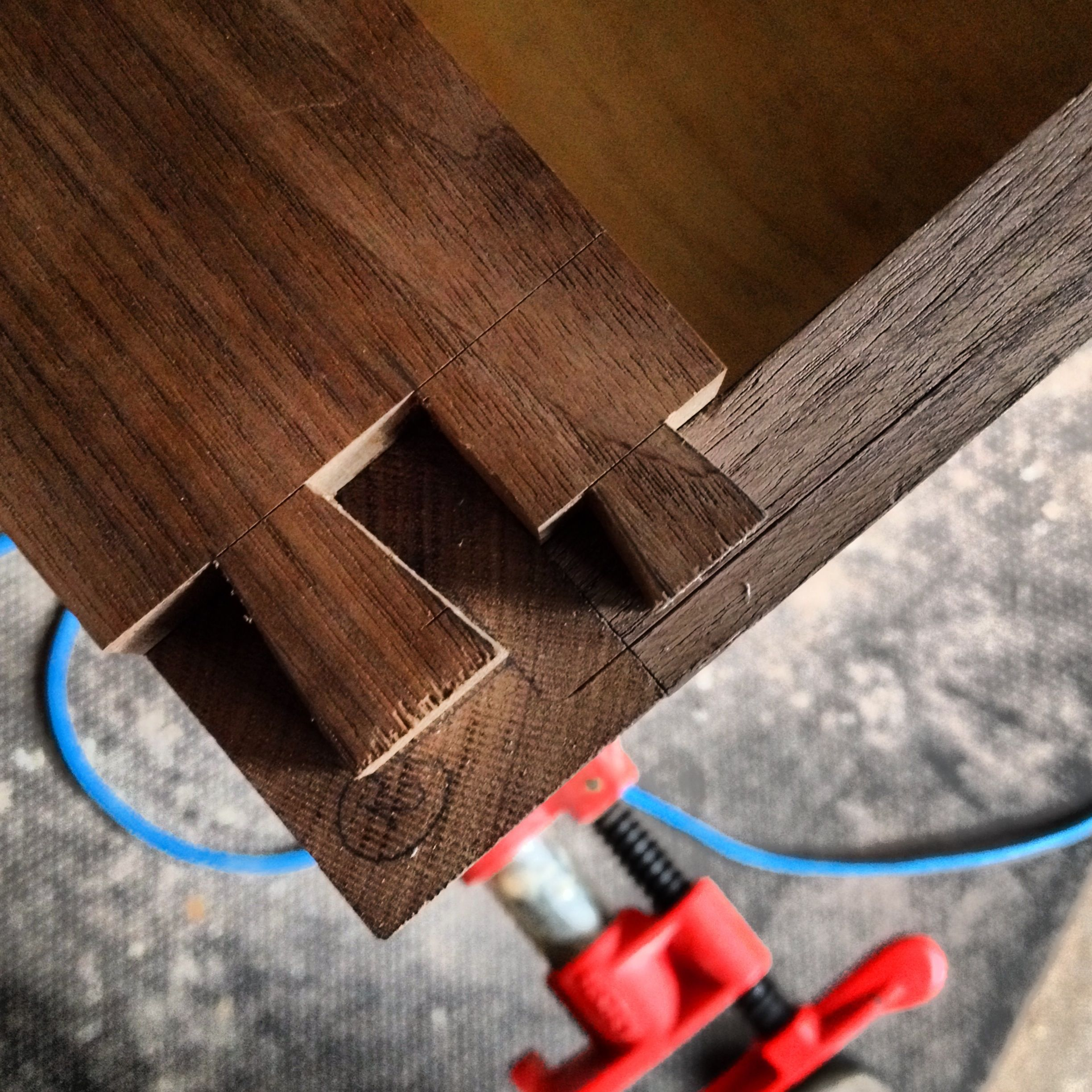 DOUBLE DOVETAIL JOINERY CLOSE-UP.