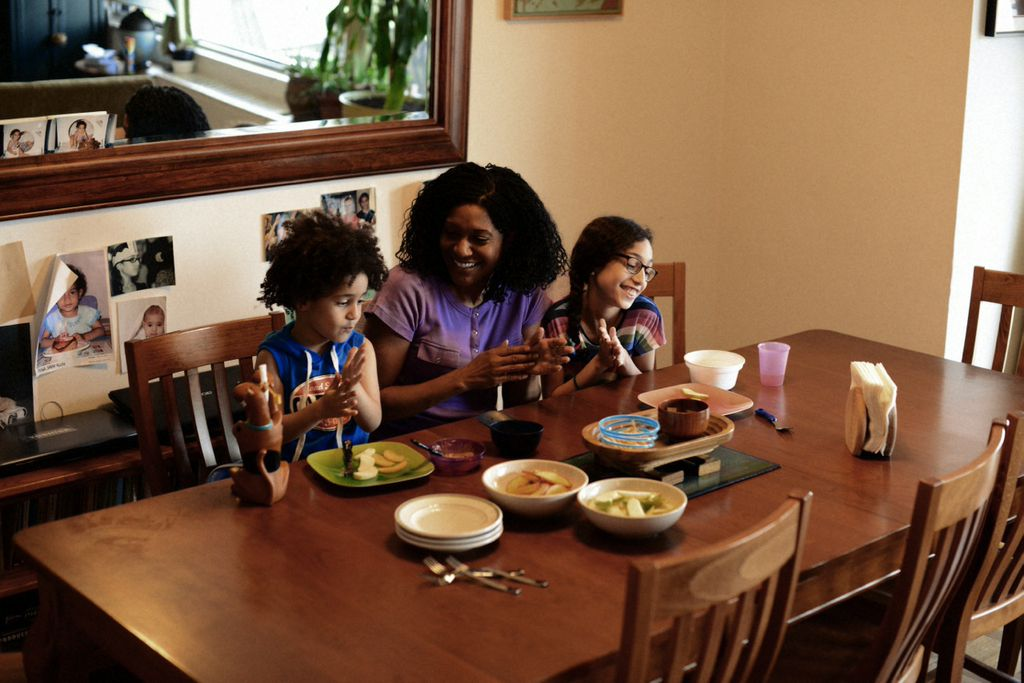 Timberly Whitfield  and her children, taken by J. Quazi King for mater mea