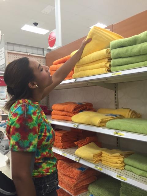 Teddi eyeing some colorful  Room Essentials ™  Fast Dry Solid bath towels .