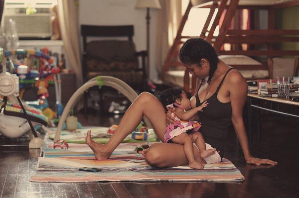 Poet and activist  Staceyann Chin  breastfeeding her daughter Zuri. Photo credit: J. Quazi King