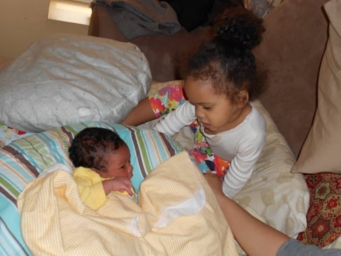 Aiden hanging out with his big sister.