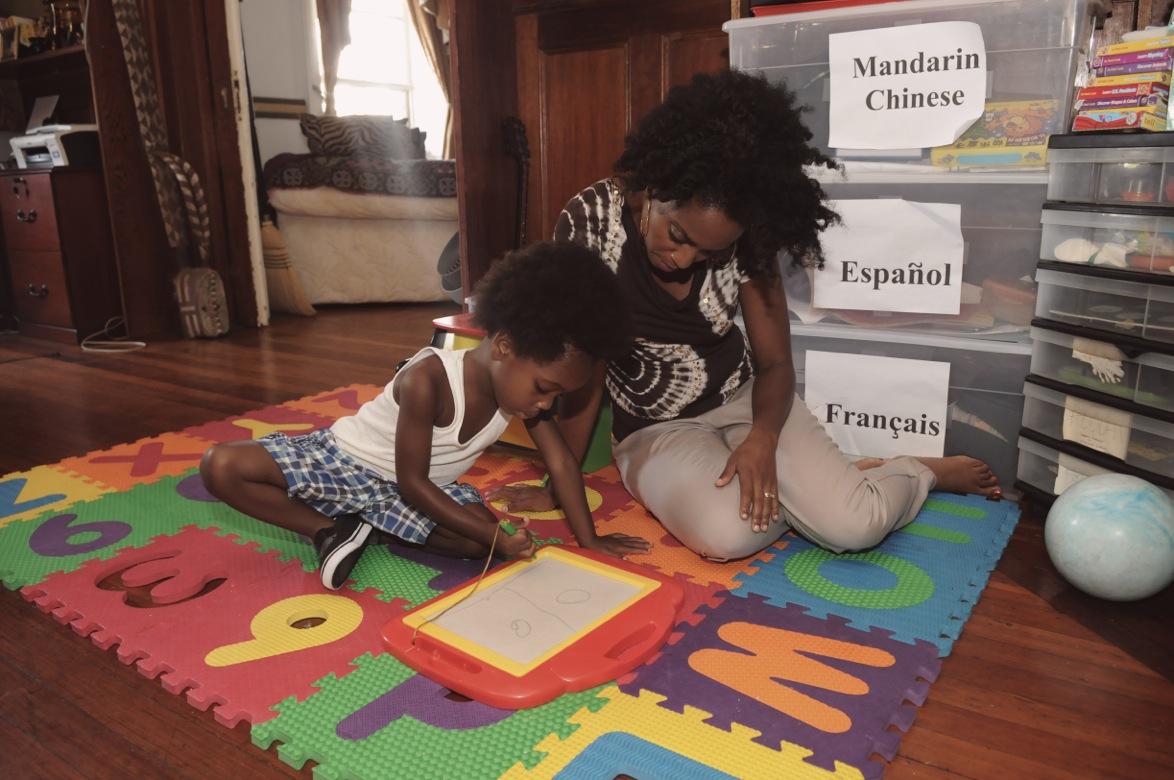 Performer Rhonda Ross Kendrick with her son Raif. Raif speaks four languages.