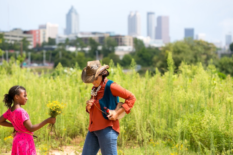 Editor and blogger Candace Morrow working on location in Atlanta with her daughter Auriana during a Country Western-themed photo shoot. Photo credit:J Coles Studio.