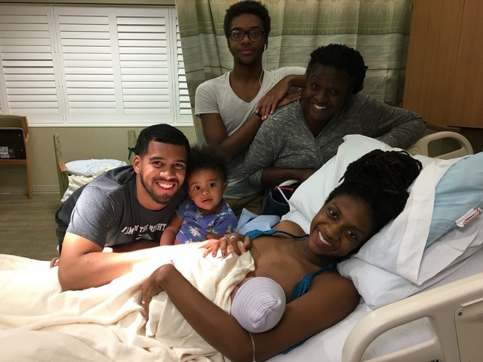 Tayo's family—her husband, daughter, brother, and mother—after she gave birth to her son, Kamalu-Ime.