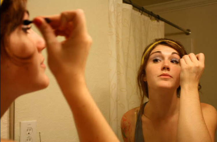 Me at 18 years old applying thick coats of makeup. Not that I actually knew what I was doing.