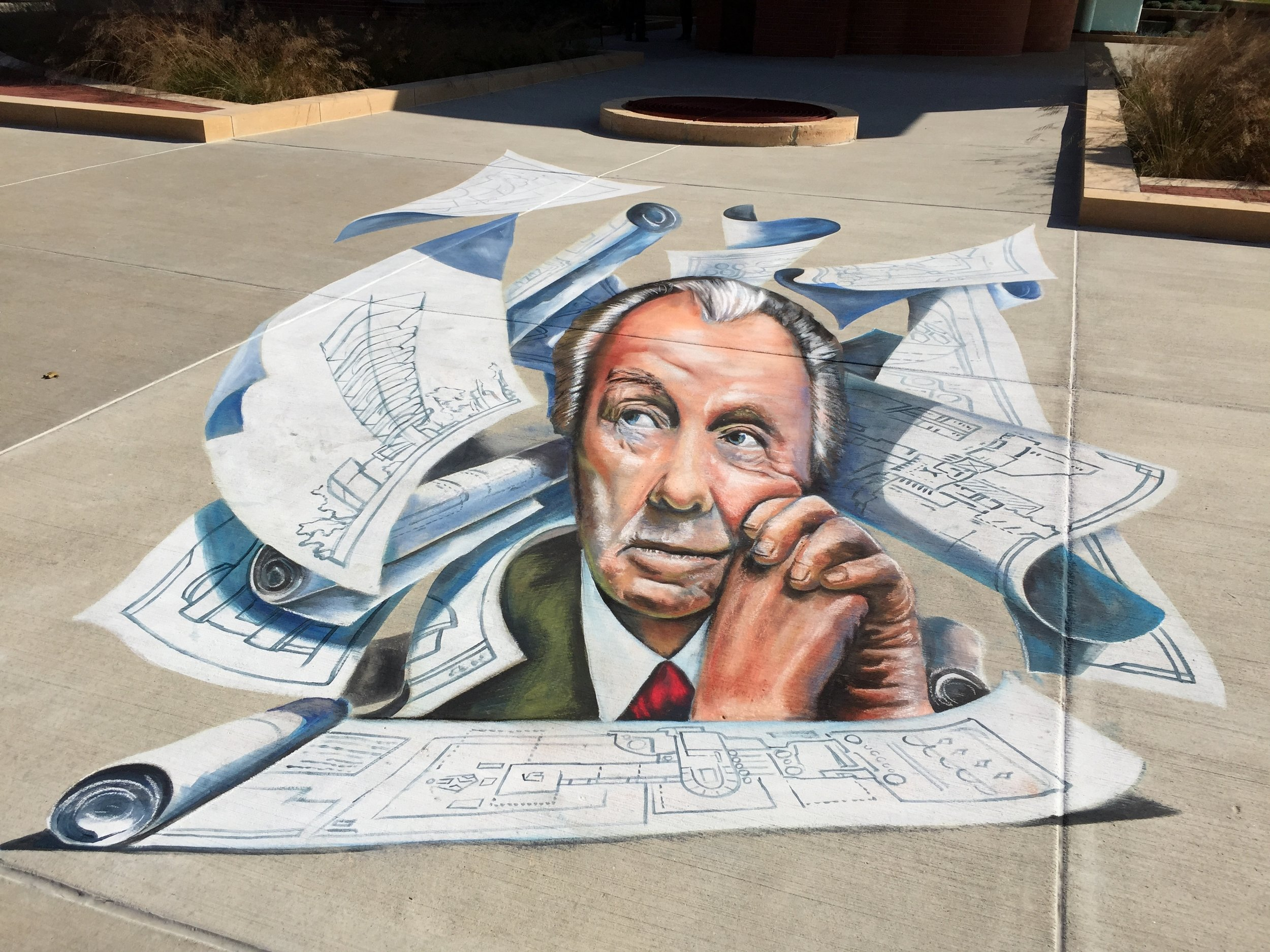 3D Chalk Frank Lloyd Wright surrounded by flying blueprints in Racine, Wisconsin