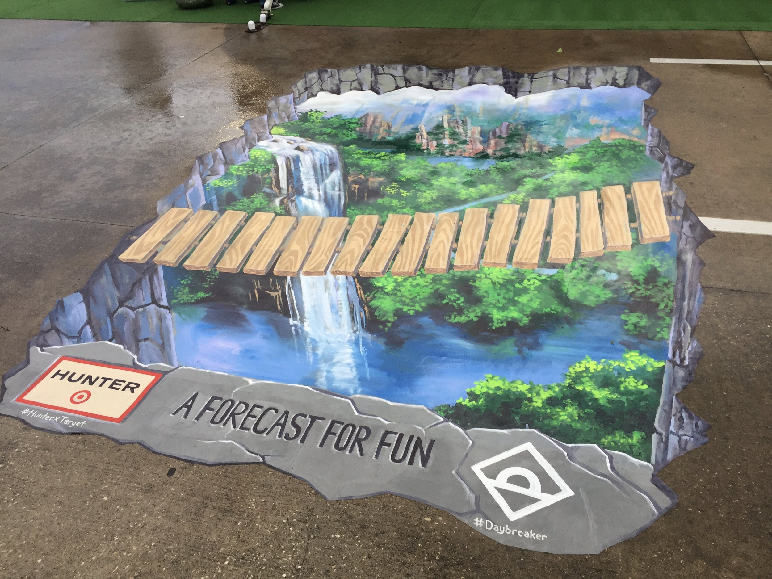 3D Street Painting at a Daybreaker event promoting Hunter and Target's cross promotion.  Wooden bridge over hole in the ground.