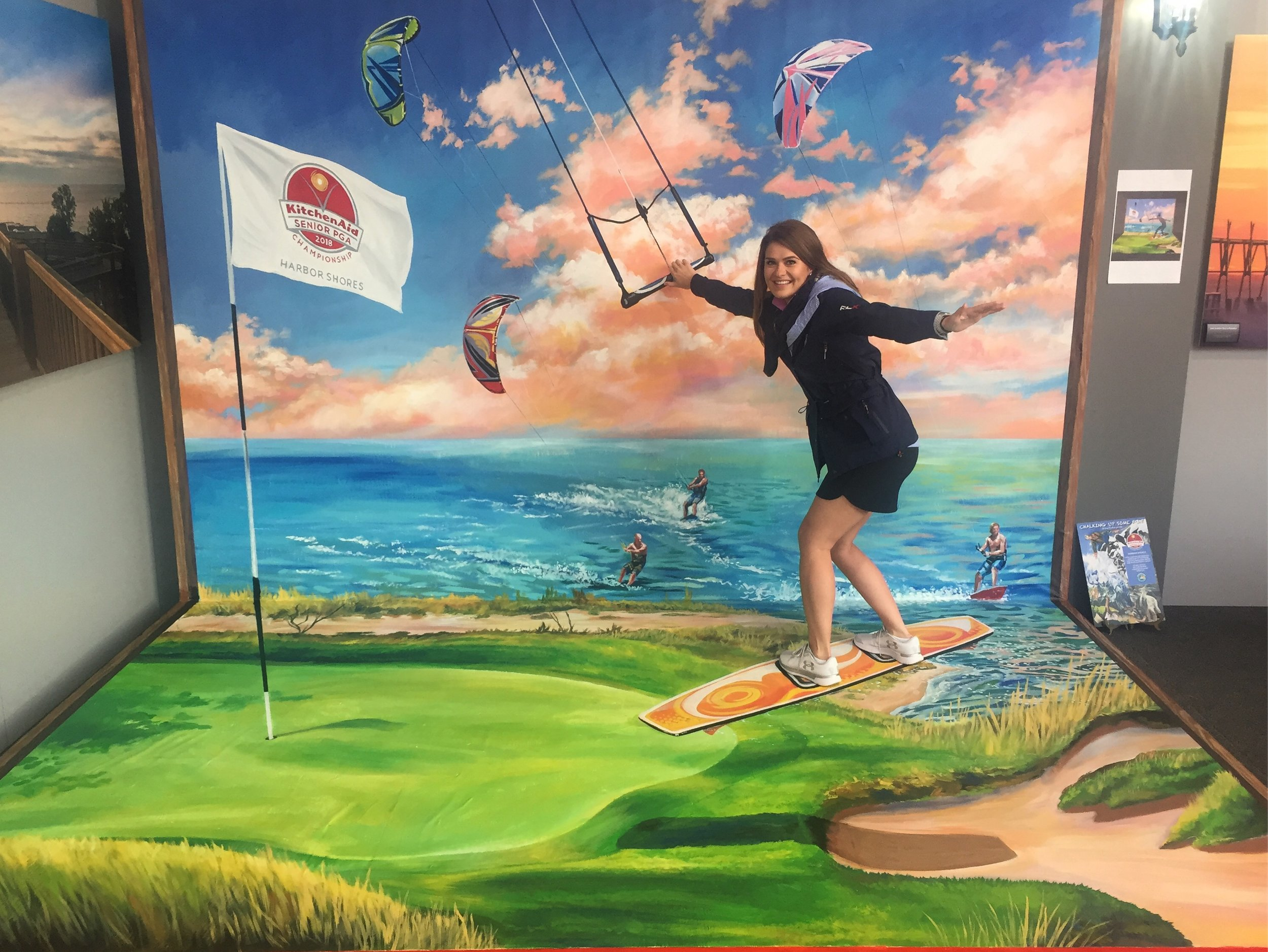 Guests get to ride a 3D kite board on the 3D artwork at the KitchenAid Senior PGA Championship.