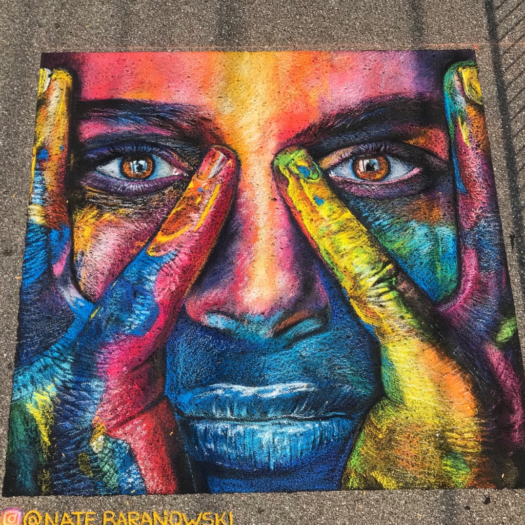 Painted Face in chalk at St Joseph Chalk the Block in St Joseph Michigan