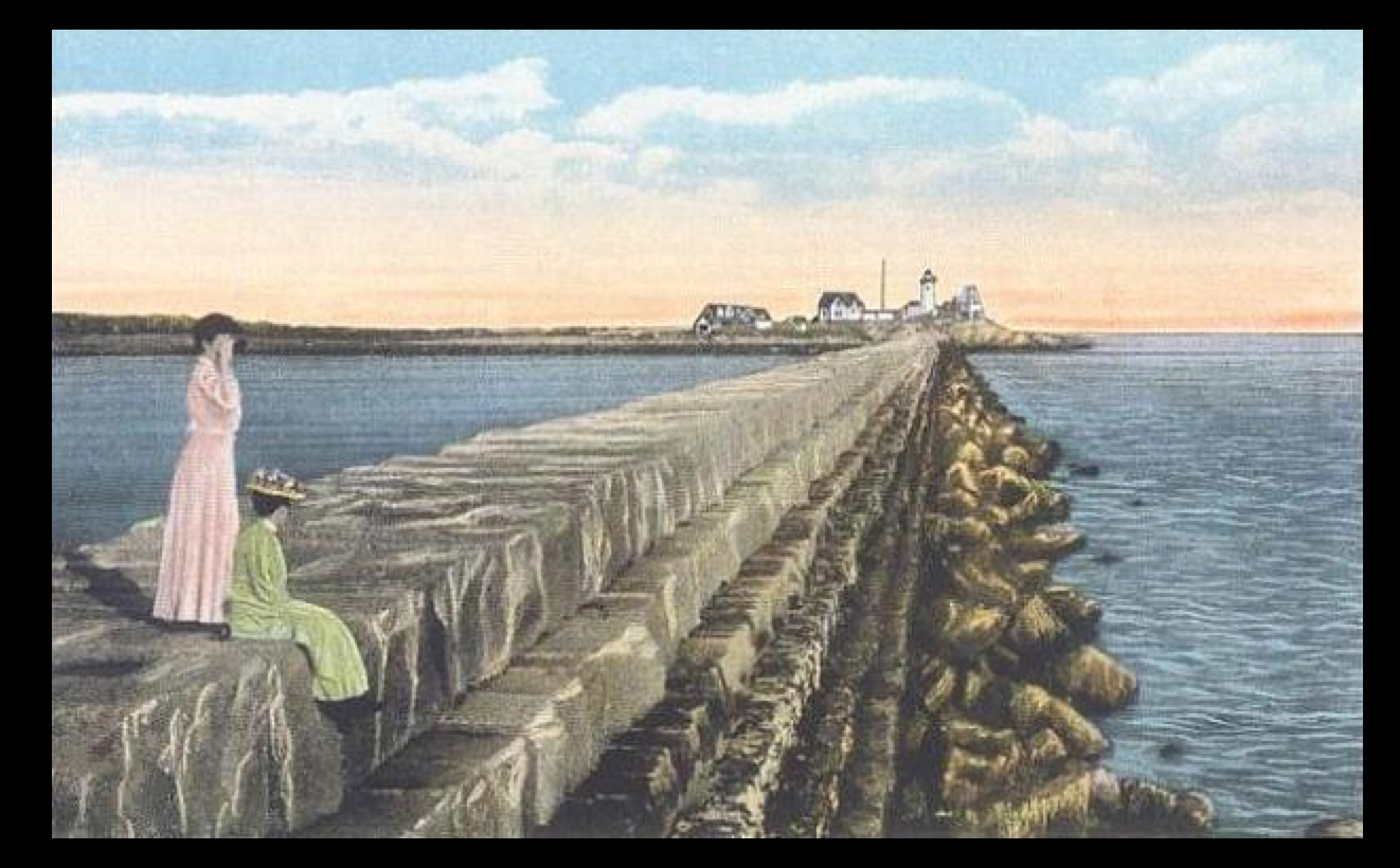 from a c. 1915 postcard.  Breakwater & Eastern Point Lighthouse, Gloucester, MA; from a c. 1915 postcard. (Public Domain)
