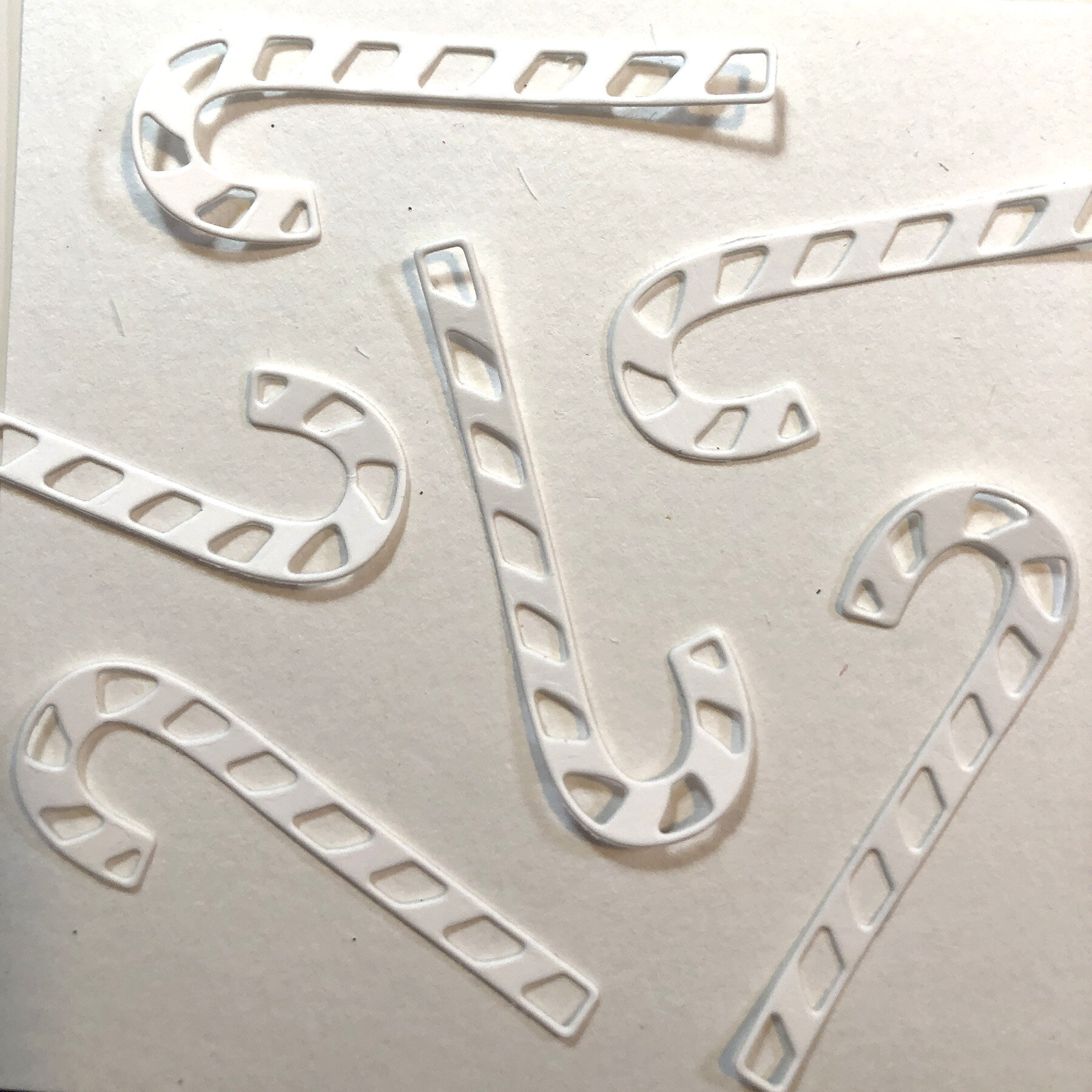 Die cut candy canes, arrange pattern.