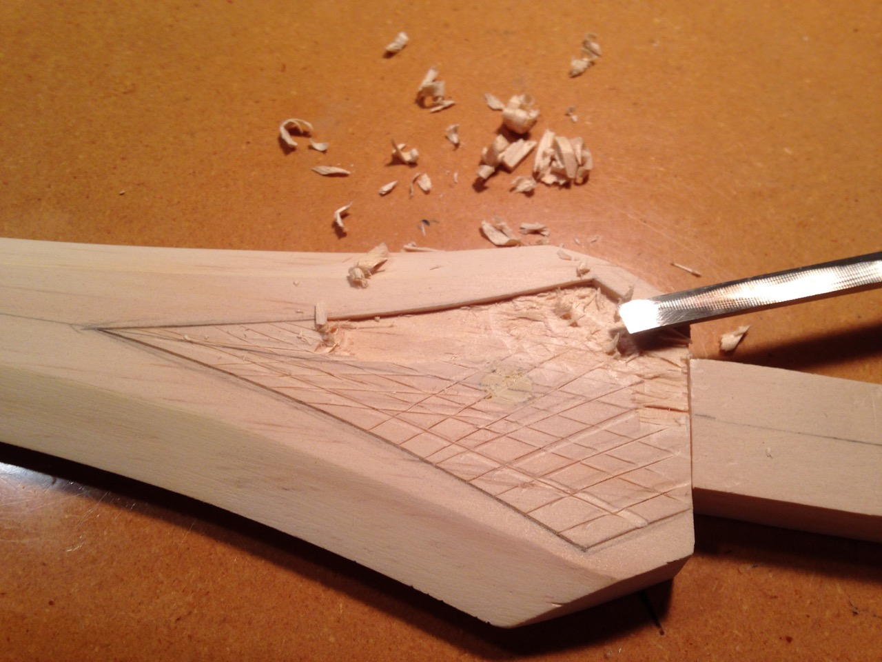 Clean out with sharp wood chisel.
