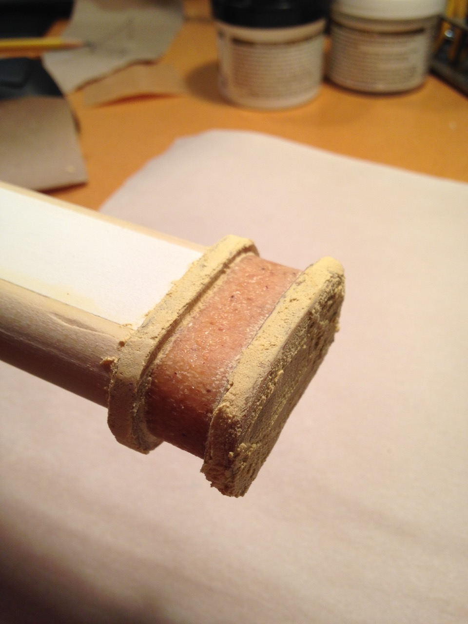 The edges of the collar need to be smooth. Step one of smoothing Worbla: wood filler skim coat.