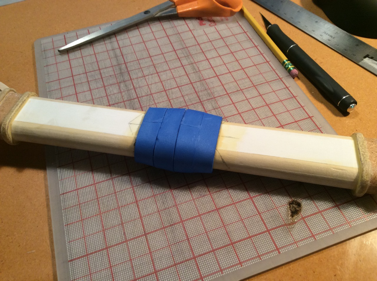 Step 2: The center pommel need to be thicker so I beefed it up with 3mm craft foam. I had to use strips because of the taper. I then smoothed it out and filled in the gaps with wood filler (sorry forgot to take a pic).