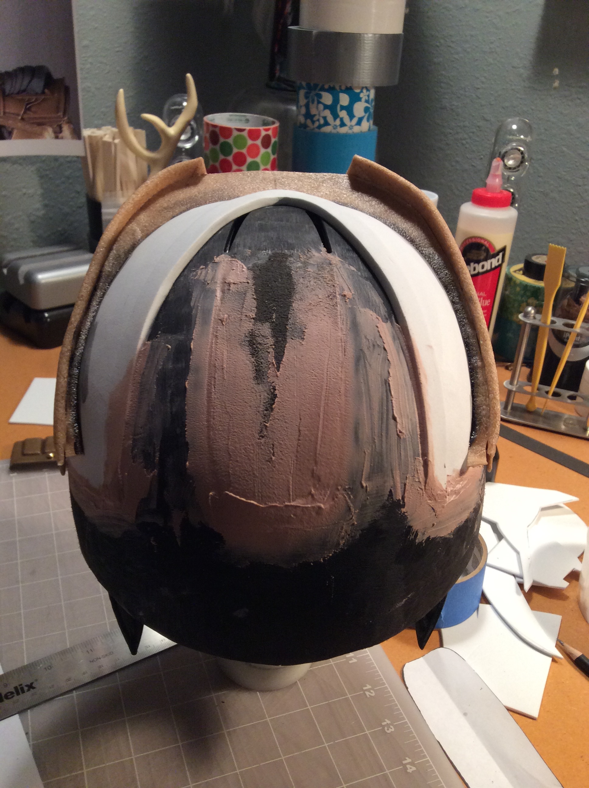 I covered the vents covered with craft foam/Worbla and Bondo. The white piece is craft foam.