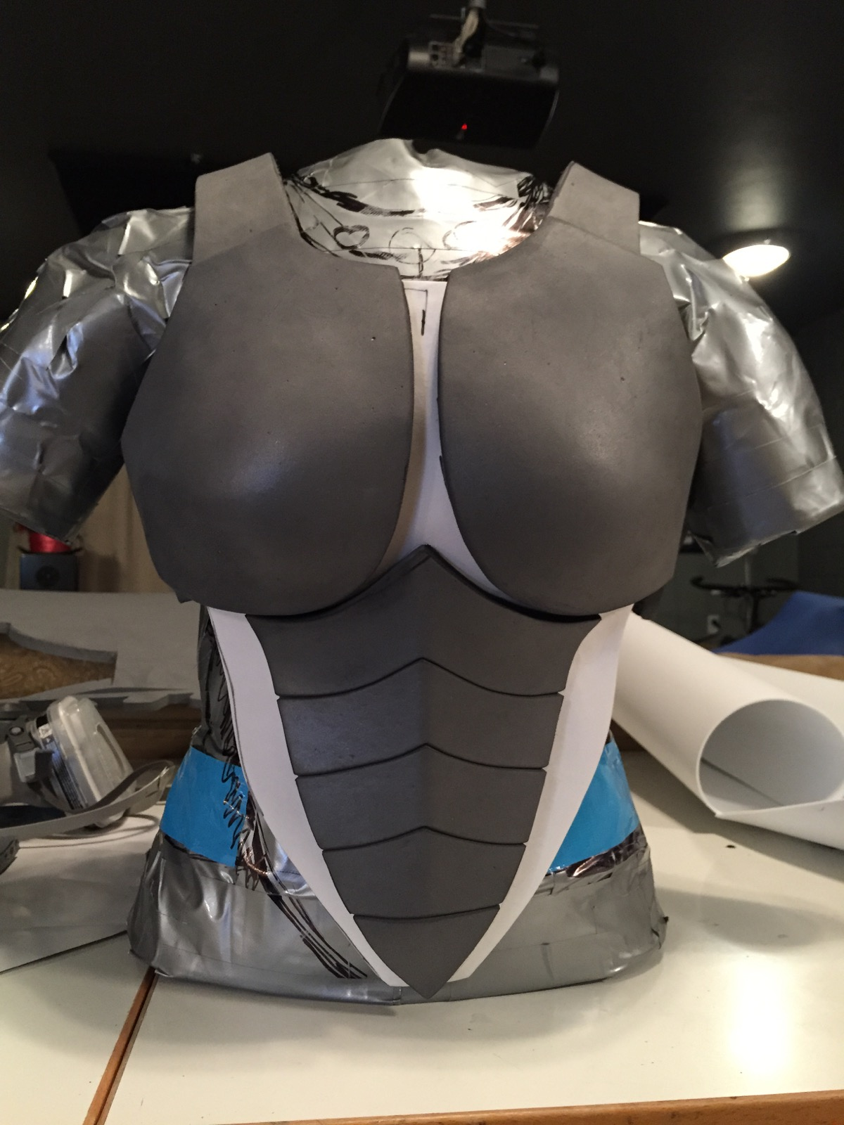 Breast pieces and mid-section adhered to standard craftfoam (white).