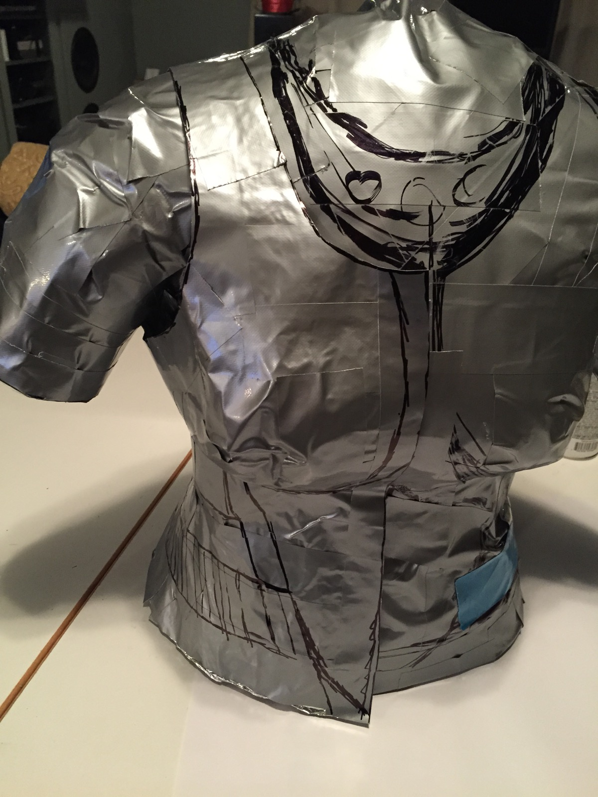 Duct-tape pattern made from wrapping the dummy with cellophane then covering that with duct-tape.