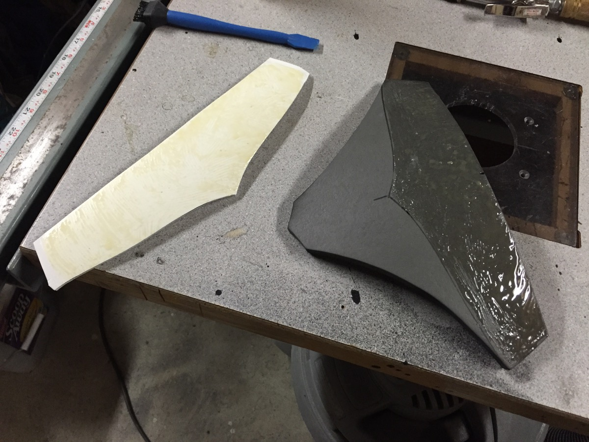 Tail piece layered parts before sticking together.