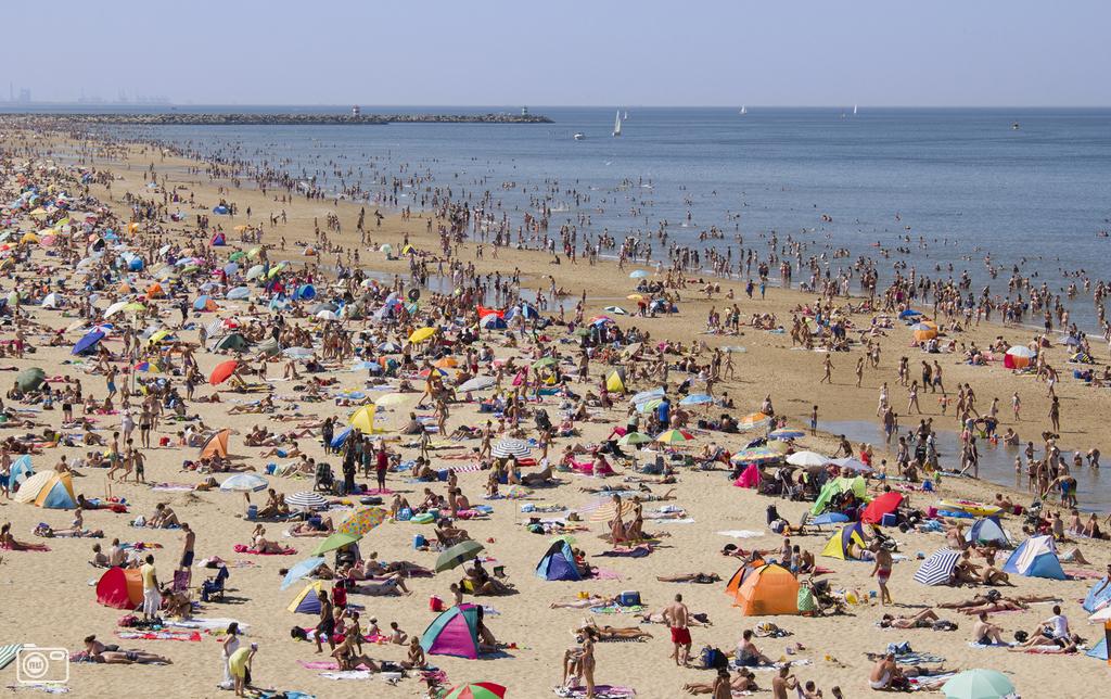 Dutch people cooling off at Scheveningen Beach near The Hague.