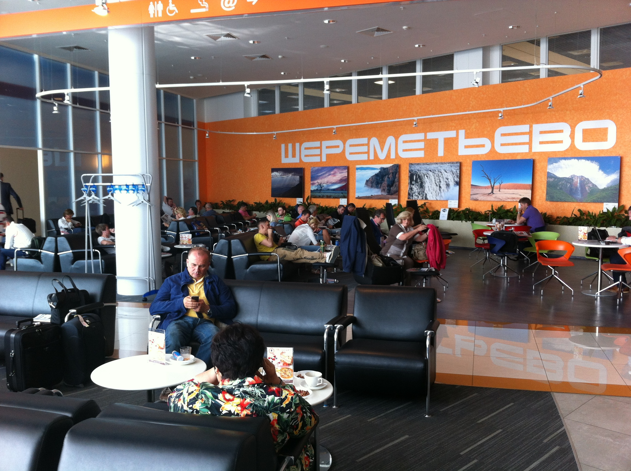 passengers relaxing in Sheremetyevo airport's business lounge