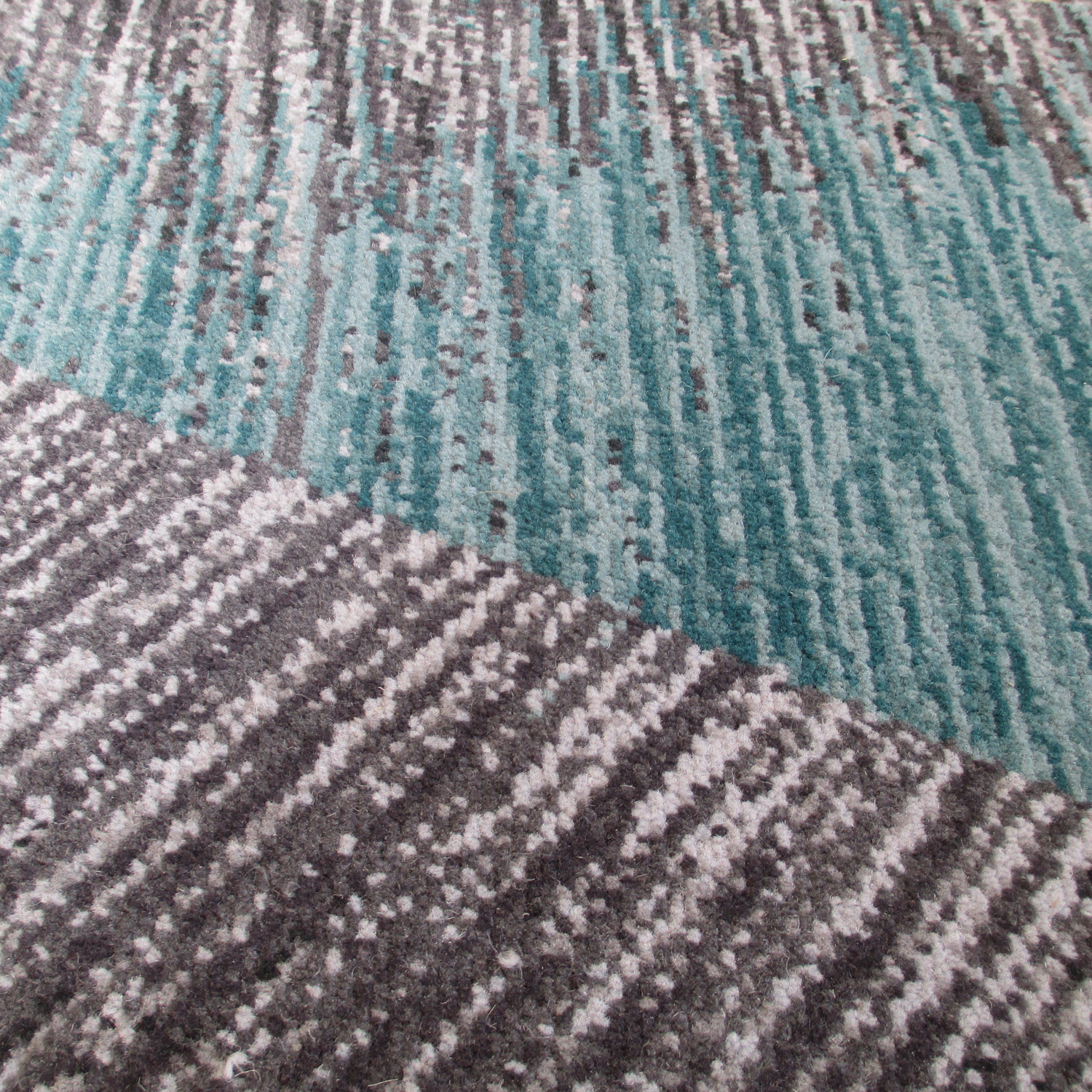 Detail of the radiating facets in theSixtyFive lounge carpet.
