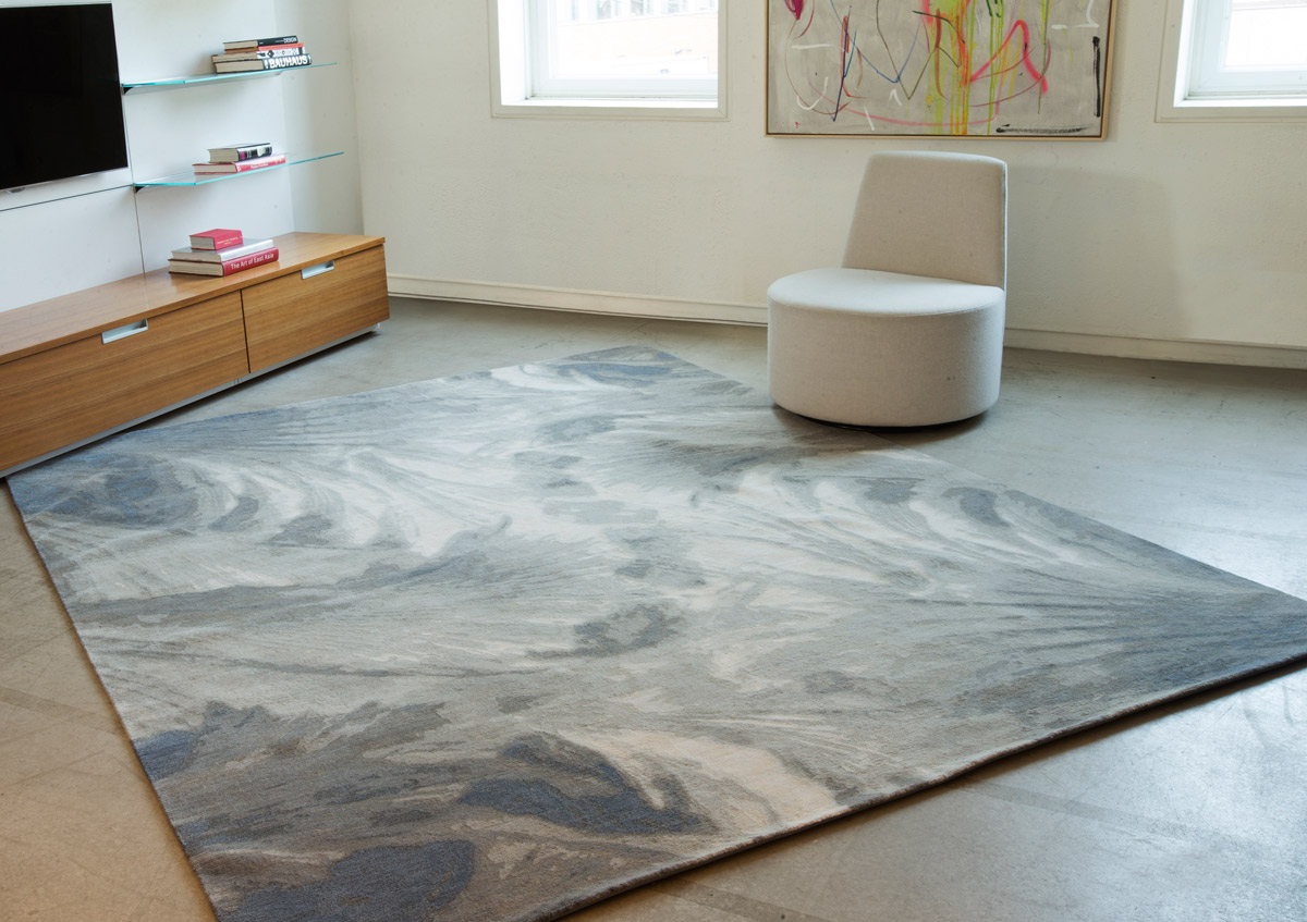 Crystallize - Ice:  Reminiscent of the delicate frost that forms on glass in winter, a beautifully balanced design that elegantly swirls across the rug. Equally at home in a contemporary or traditional interior. Imagine its simple luxury in a living room with cooler toned furnishings or even with a white marble fireplace.By Clémence Hardelay