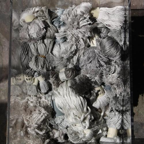 A box of grey silk poms at the studio in Toronto.