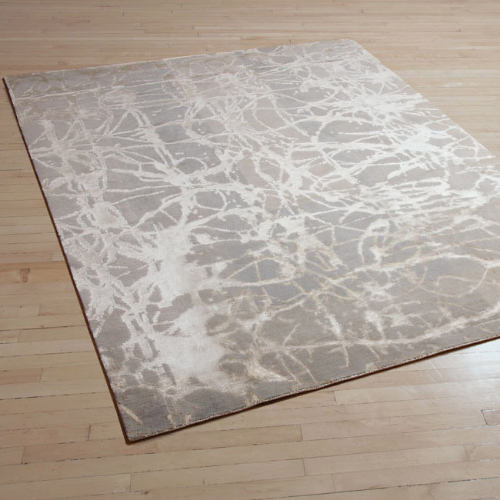 Scratch is one of the most popular designs from our collections of handknotted rugs. So popular in fact, it is available in no less than four neutral colourways: Ice (shown here), Silver, Frost and the award-winning Platinum. The rug gives the impression of layers of texture through the addition of silk, which plays to both the dark and light background tones in the colour palette.   Project: Scratch - Ice from the Aerial Collection