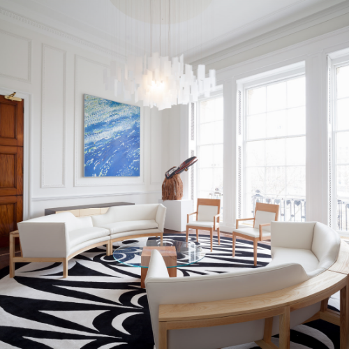 Although this rug combines two of the most common shades on the colour spectrum,and uses the simple lines of expanded scale,the fluid lines of the furniture together with the uniting British Columbia theme, create statement-making synergy.   Project: 29 rugs for Canada House, London.Original Artwork: LessLIE.Interior Design: Stantec.Photo: Ben Blossom