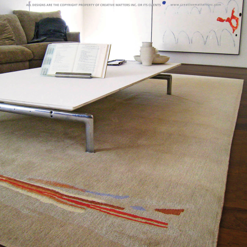 A classic rug shape and a calm neutral field make a statement when a contemporary burst of colour appears in the perfect position for the room. Nettle and wool were blended together for this piece, to add shine and to tie into the informal, elegantly comfortable feel of the room.   Project: Custom rug for a residential space.