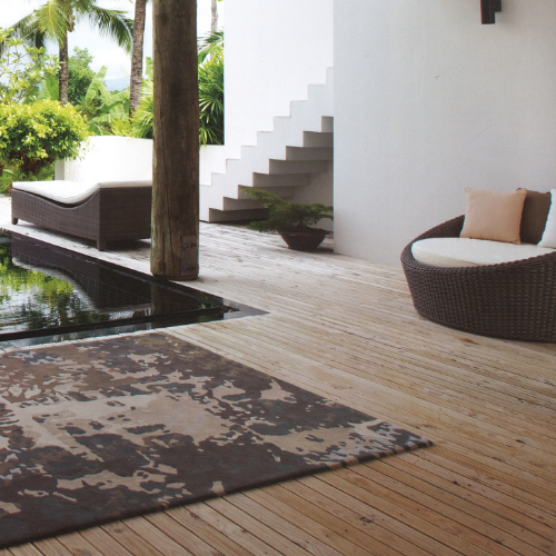 """Camouflage was one of the """"Characters, Carpets with Soul"""" collection designed for Jab Anstoetz. Using seven harmonious tones of chocolate, mauve and pale grey, the blend of colours gives the design a gentle masculinity, which ties into the furniture and brings a softness to the outdoor beach setting.   Project:  Jab Anstoetz collection.   Photo: Jab Anstoetz"""