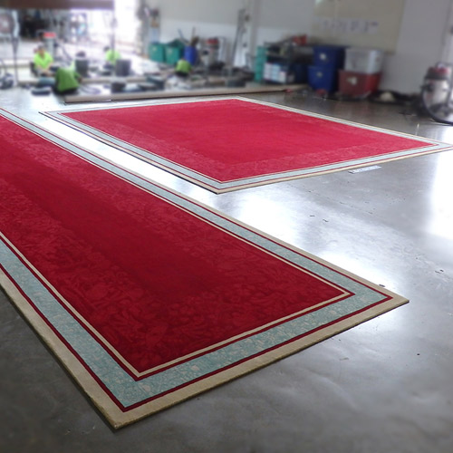 The two Creative Matters lobby rugs at the end of production process at the mill in Thailand.