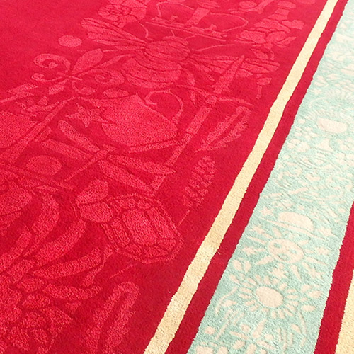 Closer inspection reveals pattern within the red runner and a complex border design.