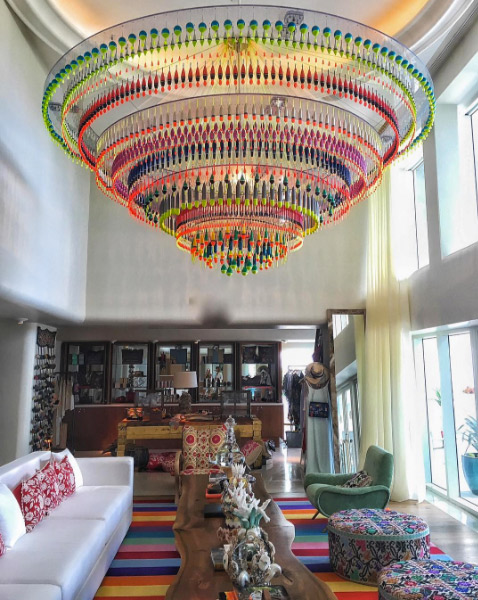 For the relaxation room,we matched the stripes in this Creative Matters rug to the chandelier constructed with fishing lures.Photo: Gnazzo Group