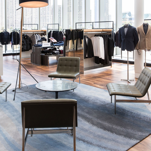 The menswear department, where soft curves in a 100% handtufted wool Creative Matters rug provide contrast to tailored clothing. Photo: Jenna Marie Wakani