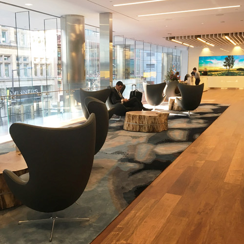 Another reception/meeting area feels both elegant and comfortable with the addition of the very long Creative Matters rug.