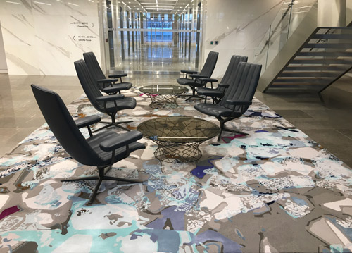 One of seven Creative Matters rugs for the stylish new Deloitte Canada office tower. Warm grey tones matched perfectly to the stone floor with surprising notes in purple, teal, burgundy and rust. Handtufted in Thailand.