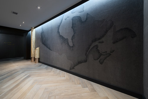 The Creative Matters map of Canada wallcovering transforms the elevator lobbies. Photo: Josh Hotz