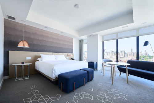 The Creative Matters ombréwallcovering with geometric floorcovering for the Standard Suites. Photo: Josh Hotz