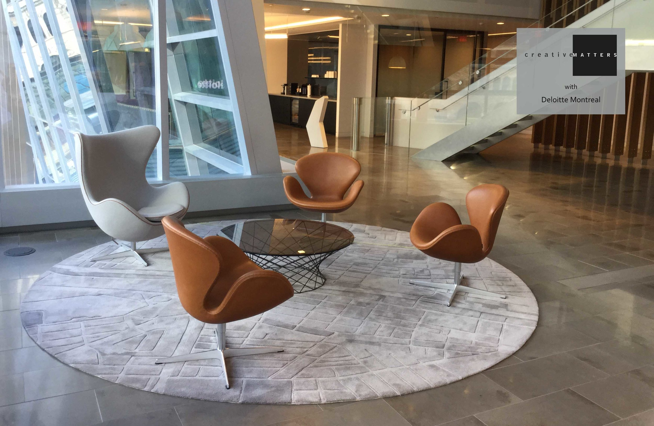 Sophisticated but simple at first glance, this circular piece is the smaller partner of a dramatic two-rug presentation in the five-story atrium of La Tour Deloitte in Montreal unveiled in the fall of 2015. In both rugs, a variety of blend combinations and pile heights accurately replicate a detailed map of Montreal.  The rug design also speaks to the tower's heritage inclusion of former rail station elements with vivid green defining the railway line against the grey background. And subtly, Deloitte's green dot logo is incorporated to mark the location of the building itself.  Project: Two rugs for the lobby of La Tour Deloitte, Montreal Interior Designer: Arney Fender Katsalids, U.K. Rug: 100% wool, handtufted in Thailand CMI Designer: Clémence Hardelay
