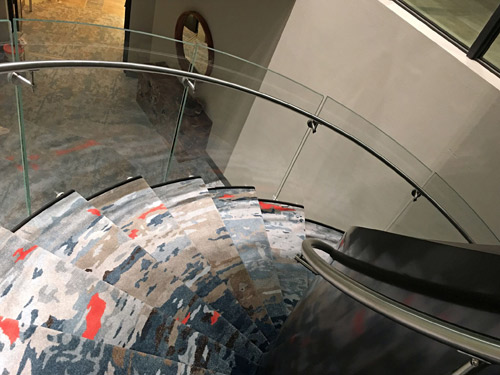 The Creative Matters design for the circular staircase comprised inset stair pieces.