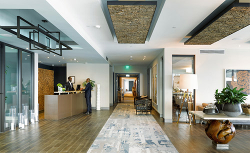 A Creative Matters lobby area rug welcomes the guests as they enter the hotel.