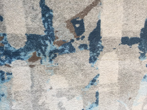 Closeup with the Creative Matters suite design. The colour palette is quietly ocean-inspired in a series of blue and sand tones.