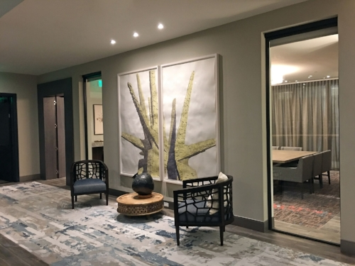 Another view of the lobby area rug, with a sneak peek of the contrasting conference room design.